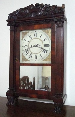 Carved top Salem Bridge shelf clock.