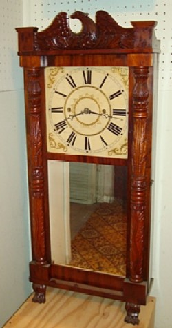 Jeromes & Darrow carved case shelf clock.