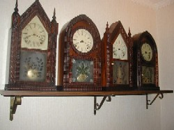 J. C. Brown ripple front shelf clocks.