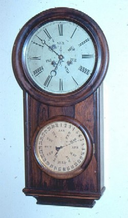 B. B. Lewis double weight driven calendar clock, Full front view.
