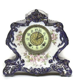 GILBERT DECORATED PORCELAIN MANTLE CLOCK, Full front view.