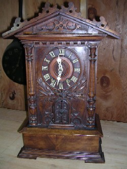 Black Forest trumpeter clock, Full front view.