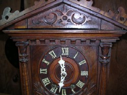 Black Forest trumpeter clock, Front upper case.