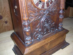 Black Forest trumpeter clock, Front lower case.